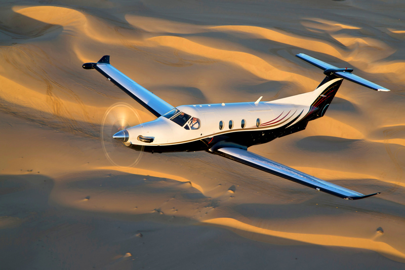 The nine-seat Pilatus PC-12 flying over the sand dunes of Namibia's Sossusvlei - © Pilatus Aircraft Ltd.