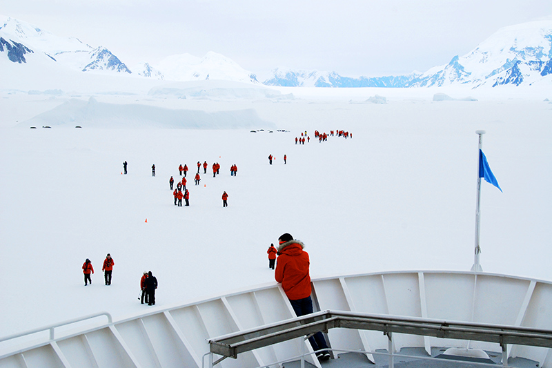 Passengers from the <em>Explorer</em> head toward - Photo by Andrew Harper resting seals at Lallemand Fjord