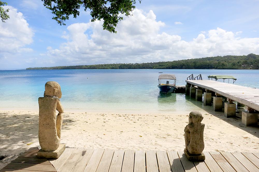 Sculptures guard the pier at Ratua Private Island
