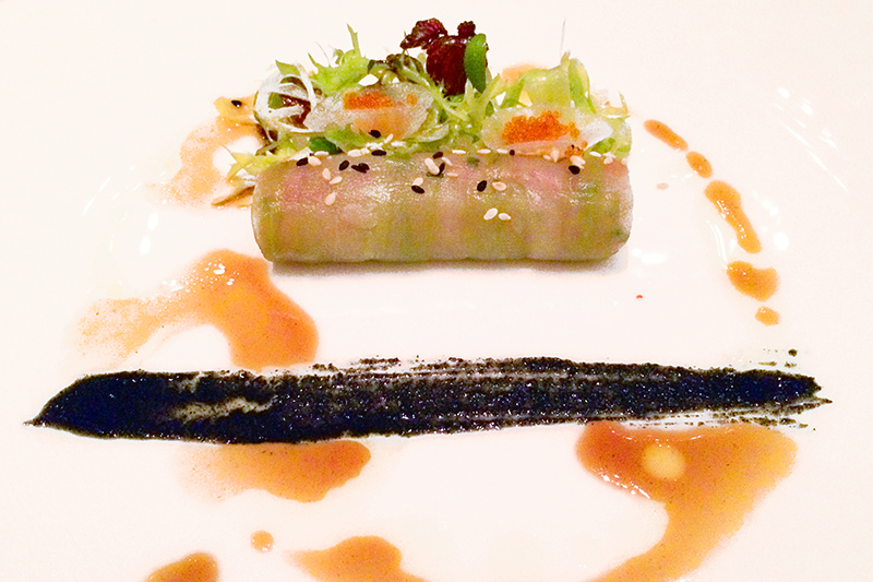 Cucumber roll of tuna tartare garnished with tobiko (flying-fish roe) at Café Gray Deluxe