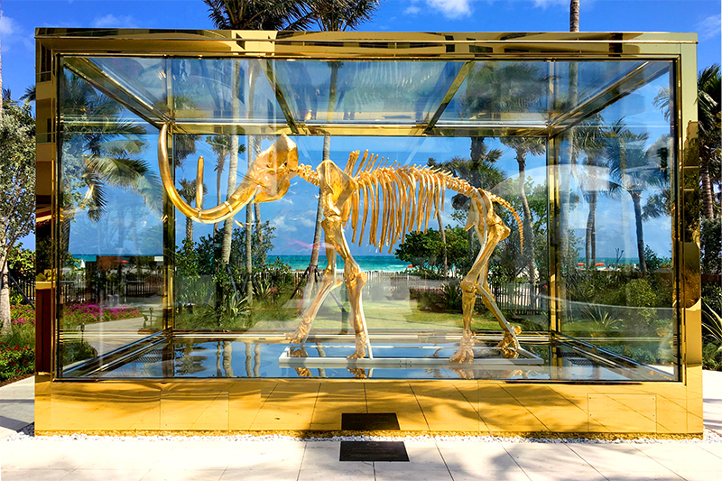 Gilded woolly mammoth by Damien Hirst in the garden at the Faena Hotel - Photo by Andrew Harper