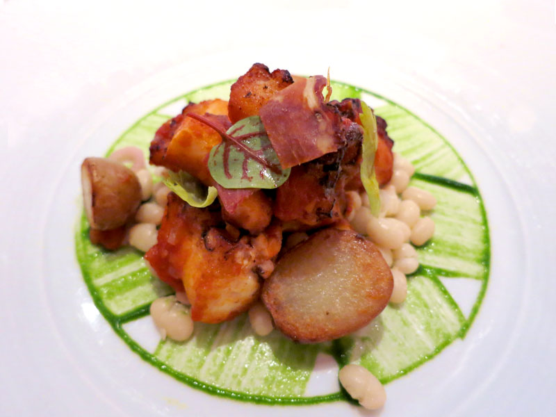 Octopus with sofrito, white beans and Serrano ham at <em>Aureole</em> - Photo by Andrew Harper