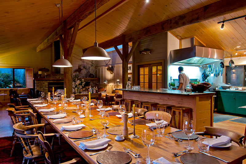 Communal dining table in main lodge building at Poronui