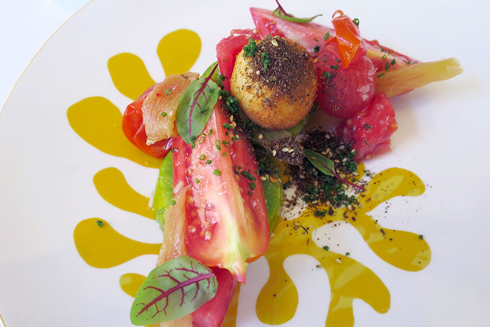 Heirloom tomatoes with crisped goat cheese, chili-inflected rhubarb and za'atar spice at <em>Menton</em>