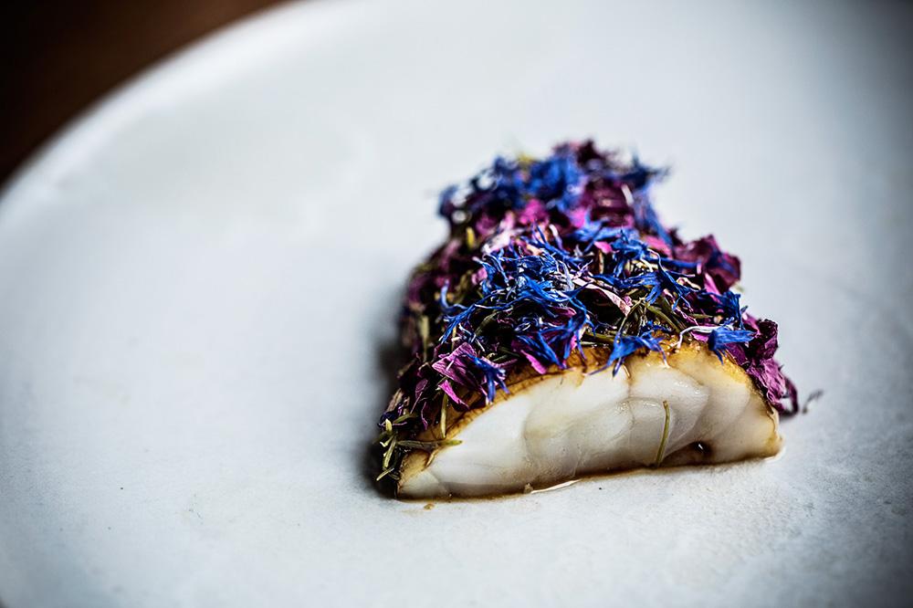 Monkfish with edible flowers from <em>Restaurant Domestic</em> in Aarhus, Denmark