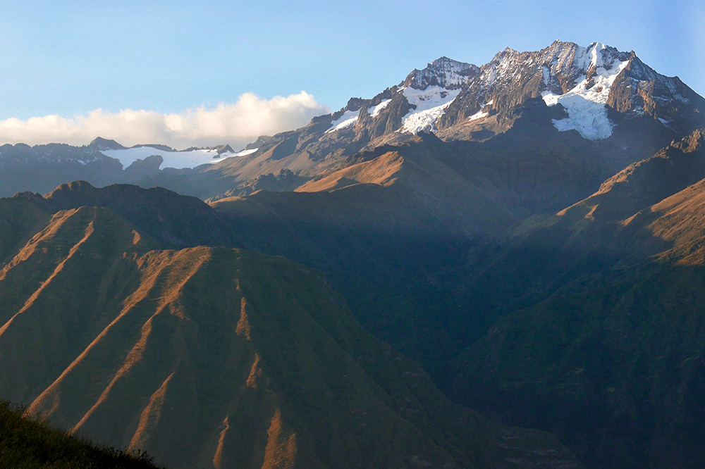 Snow-covered mountain peaks seen from our hike in the Sacred Valley, Peru - Photo by Andrew Harper