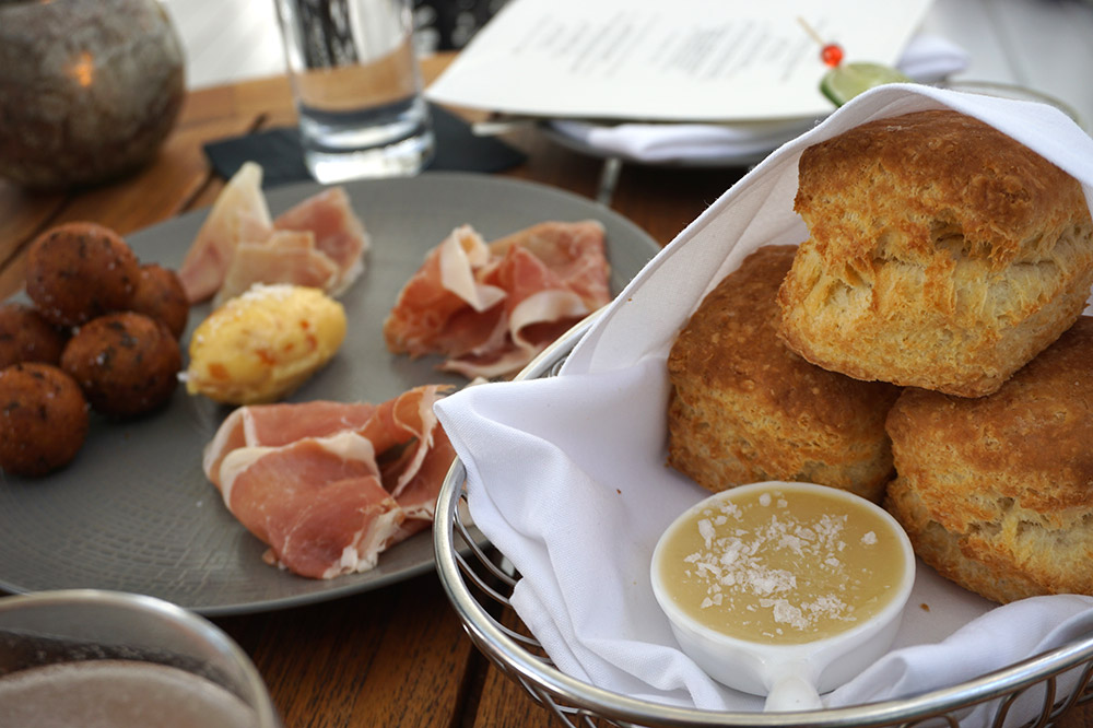 The Southern Ham Belt with ham from North Carolina, Virginia and Tennessee and <em>Olamaie</em>'s off-menu biscuits and honey butter.