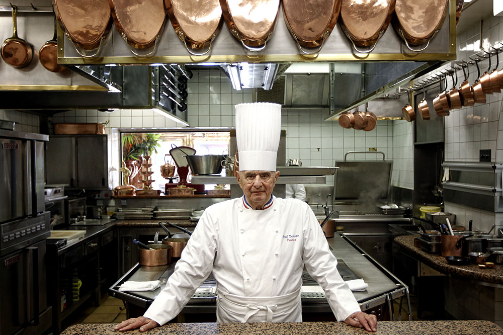 Chef Paul Bocuse in the kitchen of his restaurant, <em>L'Auberge du Pont de Collonges</em>, in Collonges-au-Mont-d'or, France