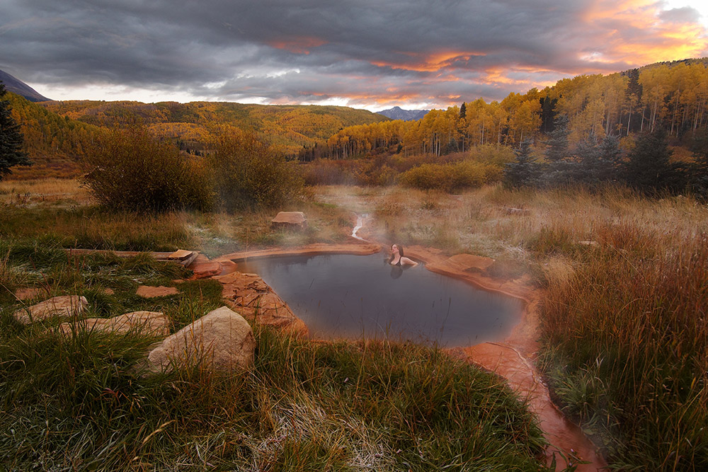 A guest relaxes in the natural warmth of Dunton Hot Springs