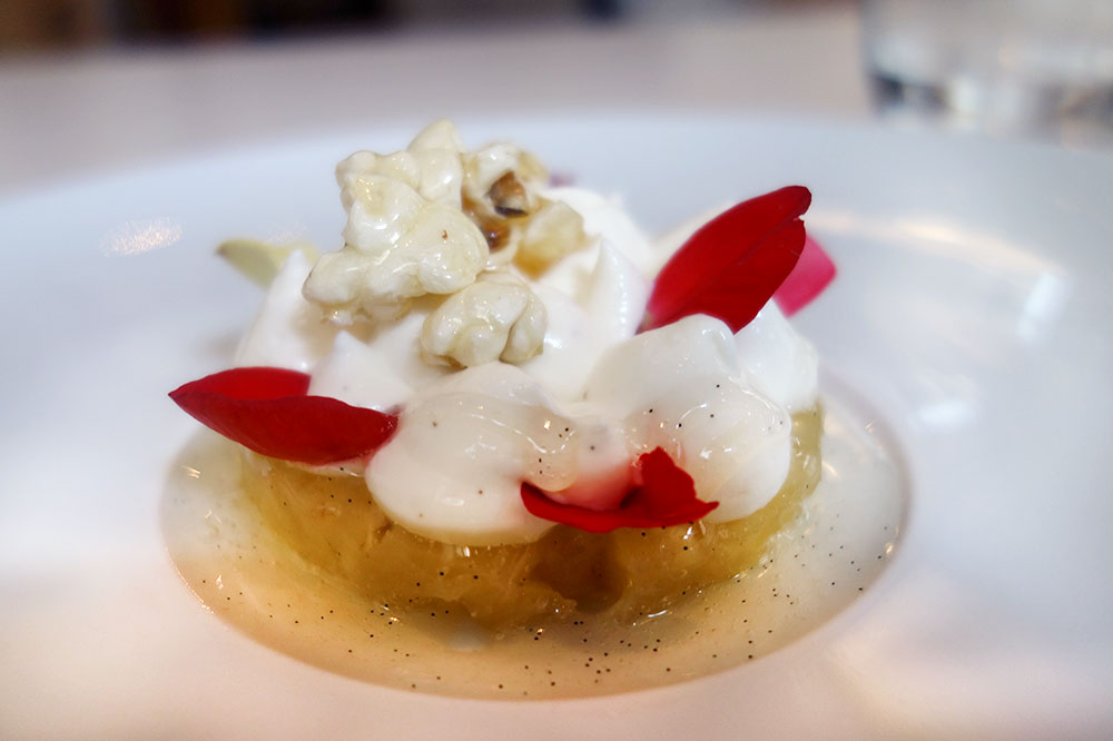 Poached pineapple with popcorn and begonia petals from <em>Takao Takano</em>