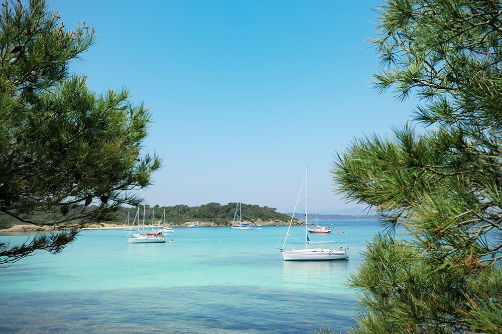 Sailboats anchored off the island of Porquerolles, France
