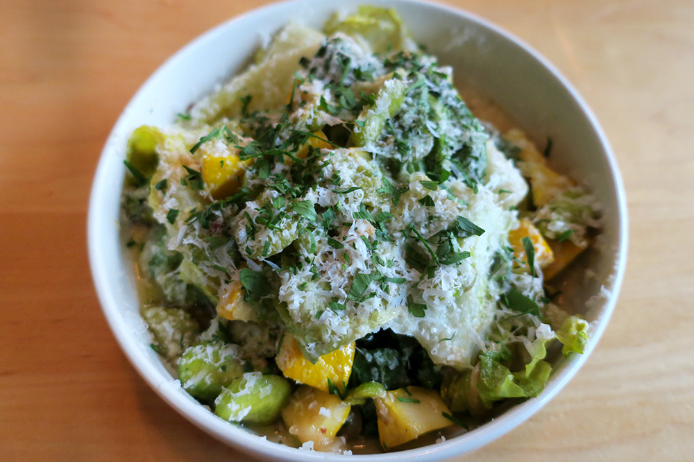 Ragout of fava beans, zucchini, escarole, basil and mint with aged goat cheese and toasted garlic-anchovy vinaigrette from <em>Ox</em> in Portland, Oregon - Photo by Andrew Harper