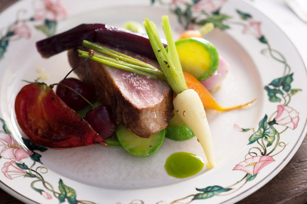 A seasonal dish with fresh vegetables at <em>Le Canon</em>