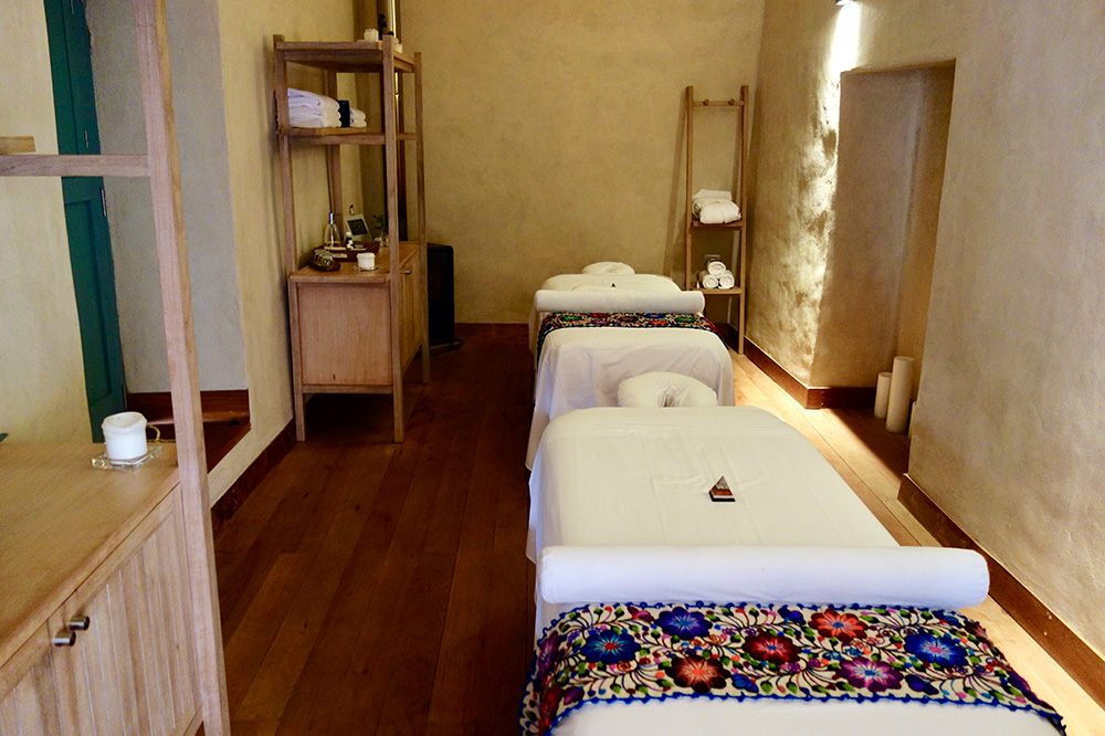 Massage tables in a treatment room at the Spa Pumacahua Bath House at explora Valle Sagrado
