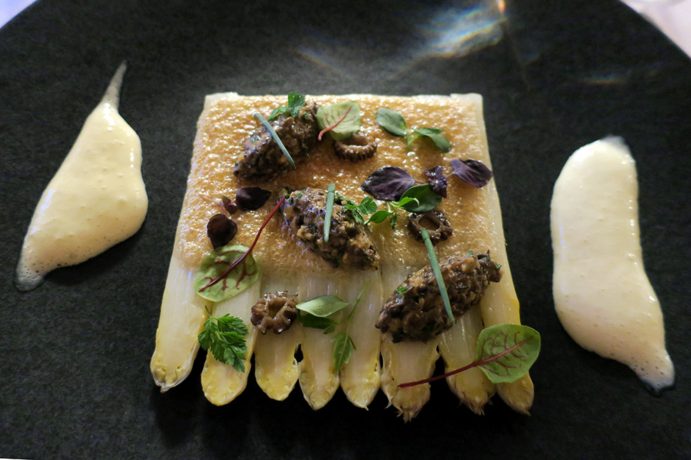 White asparagus with walnut crust, morel duxelle and lemon sabayon from the Louis XIII salon at Château de la Treyne in Lacave, France