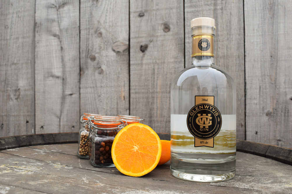A bottle of GlenWyvis gin, with orange, the recommended garnish