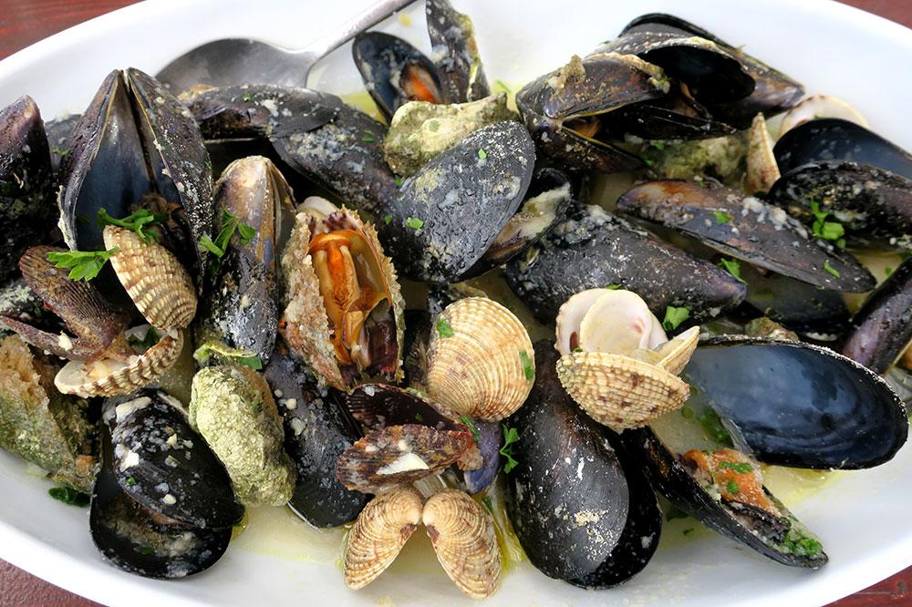 "Shellfish ""buzara,"" with mussels, scallops and two kinds of clams in a garlic-white wine sauce, from <em>Seosko Domaćinstvo Ficović</em> in Hodilje, Croatia"