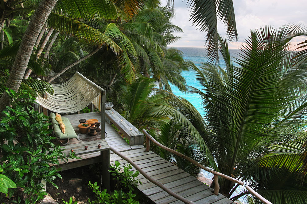 A walkway leading to seating with a view of the Indian Ocean at North Island in the Seychelles