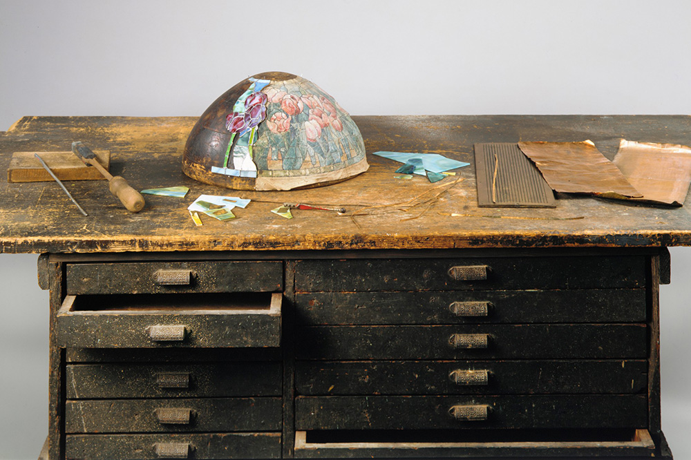 A soldering iron and workbench from Tiffany Studios displayed at The Metropolitan Museum of Art