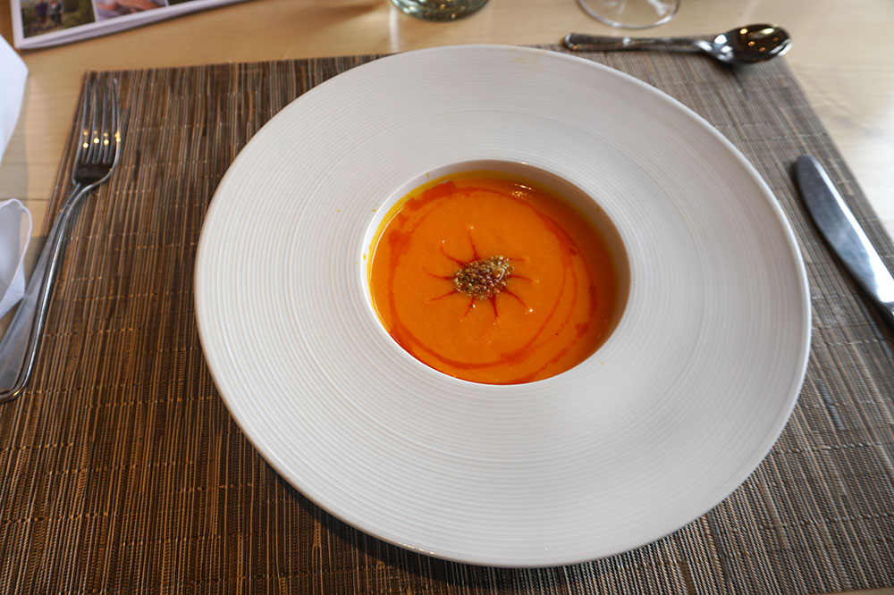 Ginger-carrot bisque with smoked guajillo chile oil and pepita powder from <em>Blue Heron Restaurant</em> at Sunrise Springs Spa Resort