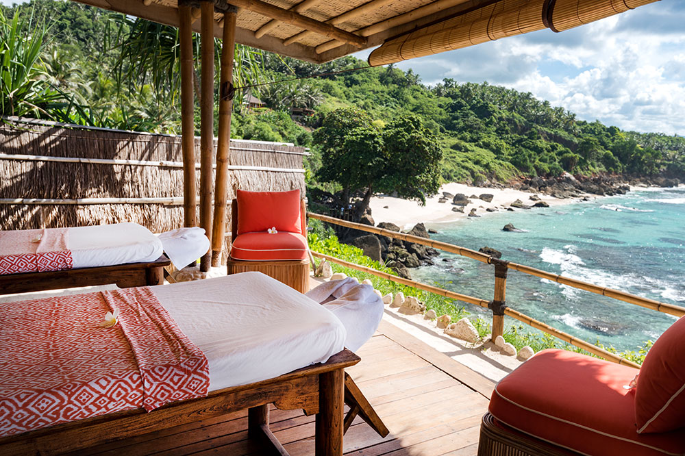 Massage tables overlooking the ocean at Nihi Sumba