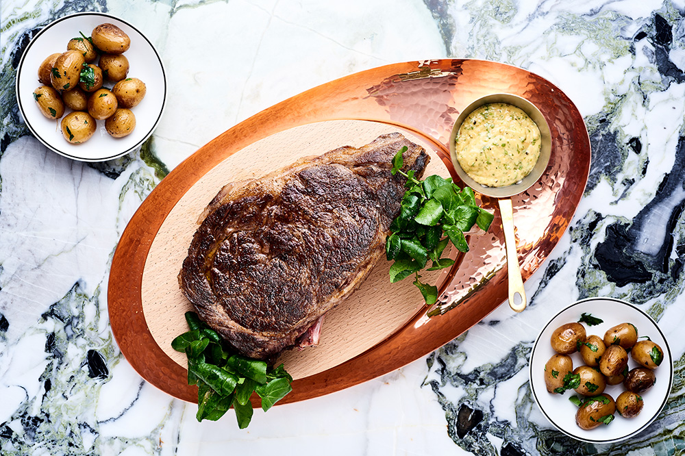 Steak with potatoes cooked in goose fat from <em>The Clover Grill</em> in Paris
