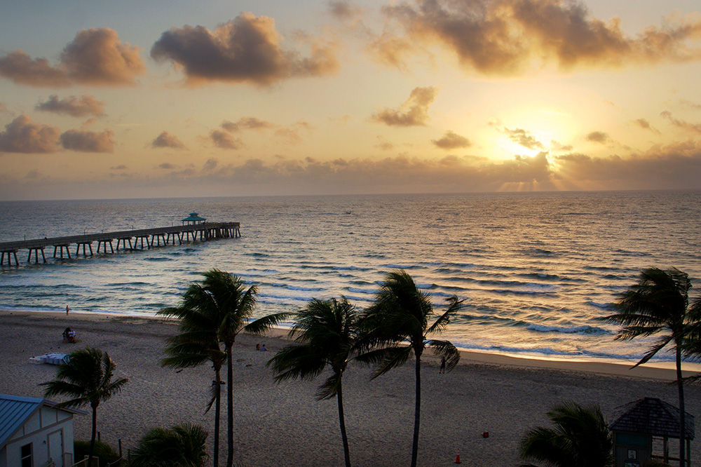 The view from <em>Chanson</em> restaurant of the beach at sunrise at Royal Blues Hotel