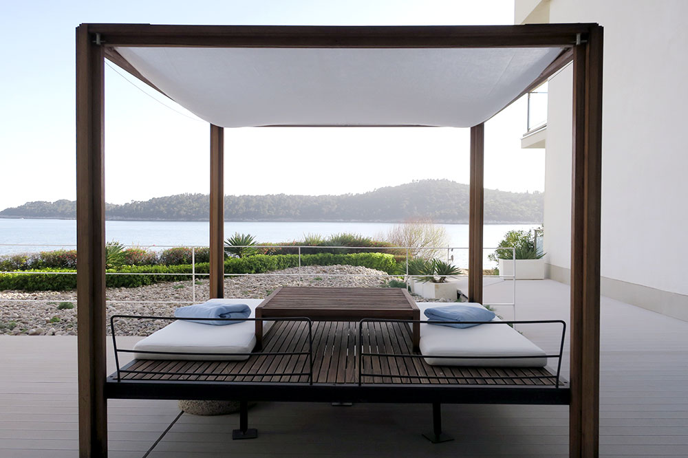 A daybed on the terrace by the pool at Villa Dubrovnik in Dubrovnik