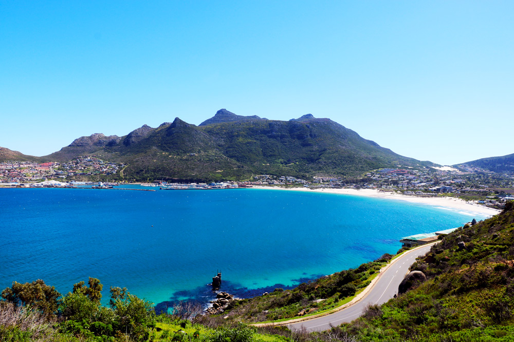 View of Hout Bay during a sunny day from Chapman's Peak Drive