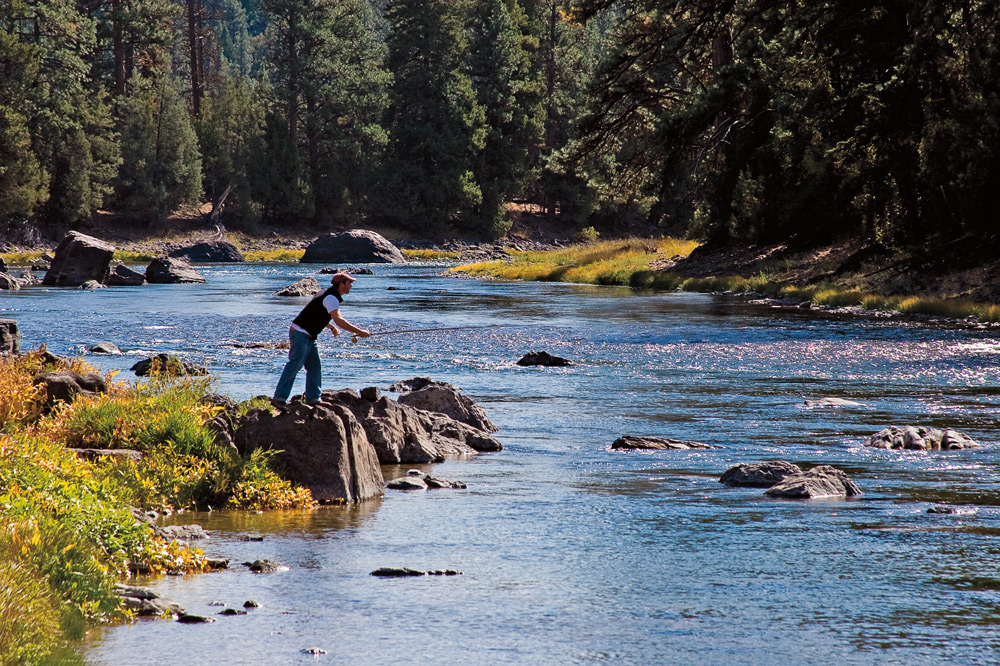 Fly-fishing on the Blackfoot River at the Resort at Paws Up