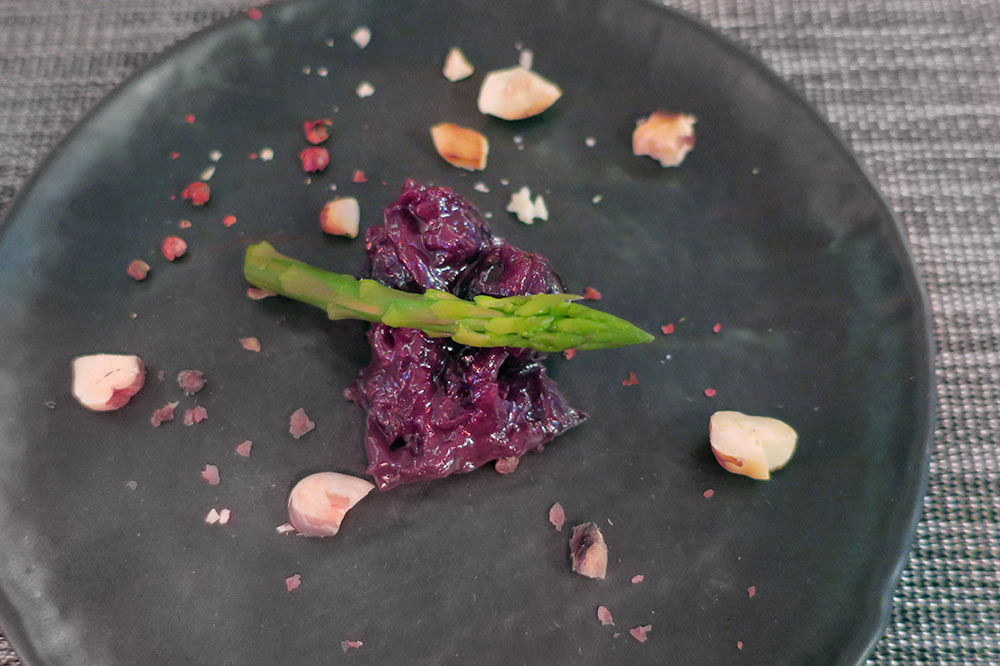 An amuse-bouche of asparagus with hazelnuts, pink peppercorns and blueberry-onion marmalade from <em>Restoran Don Dino</em> in Trogir, Croatia