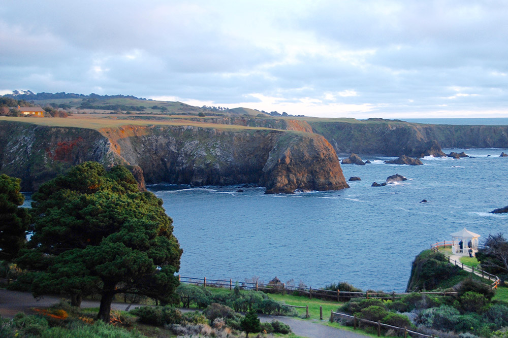 A view of the grounds and the Pacific Ocean at The Heritage House Resort, Mendocino, California