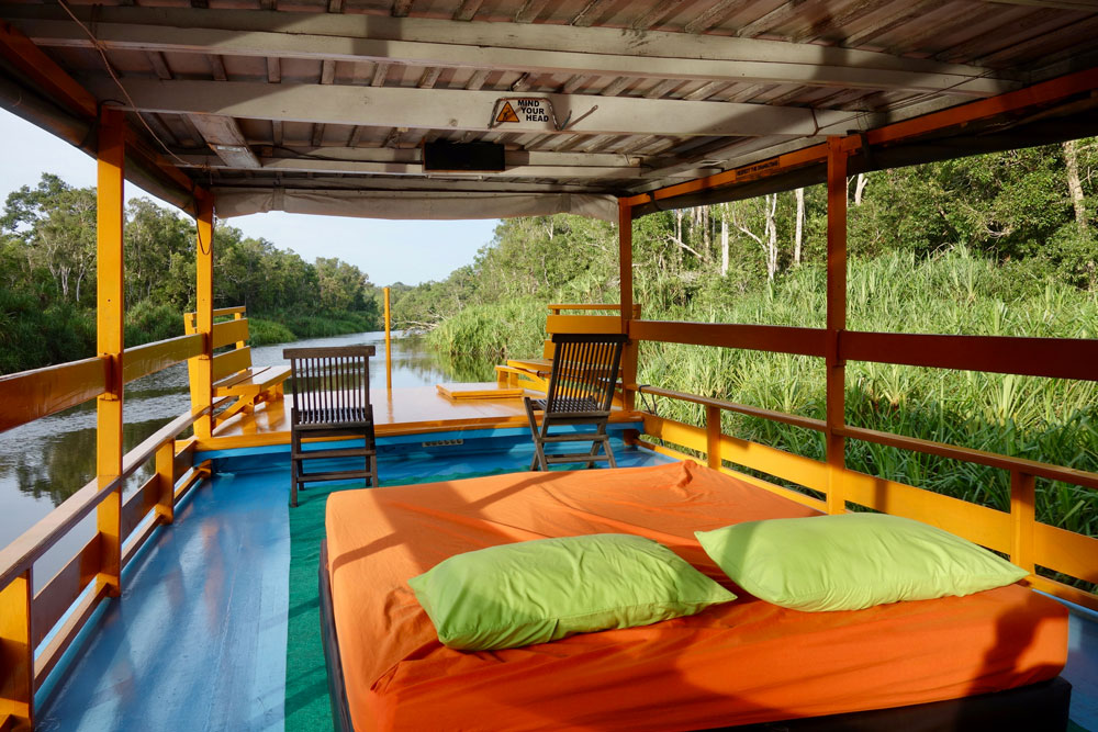 The deck of our wooden klotok riverboat