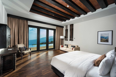 Jabal Villa bedroom with private terrace and mountain views
