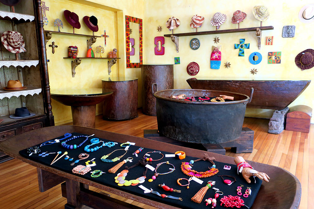 Assortment of wall hangings, jewelry and hats at Olga Fisch Folklore