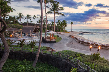 The hotel grounds and beach at The Four Seasons Resort Hualalai, Hawaii