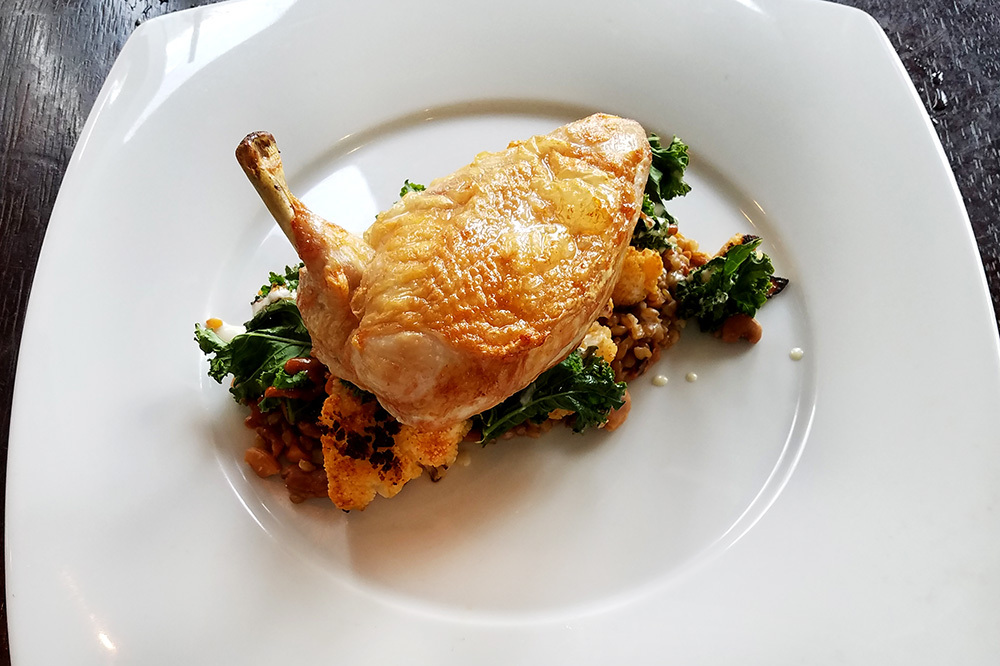 Roasted kale-and-farro salad with chicken from Halcyon, Flavors from the Earth in The Mint Museum in Charlotte, North Carolina