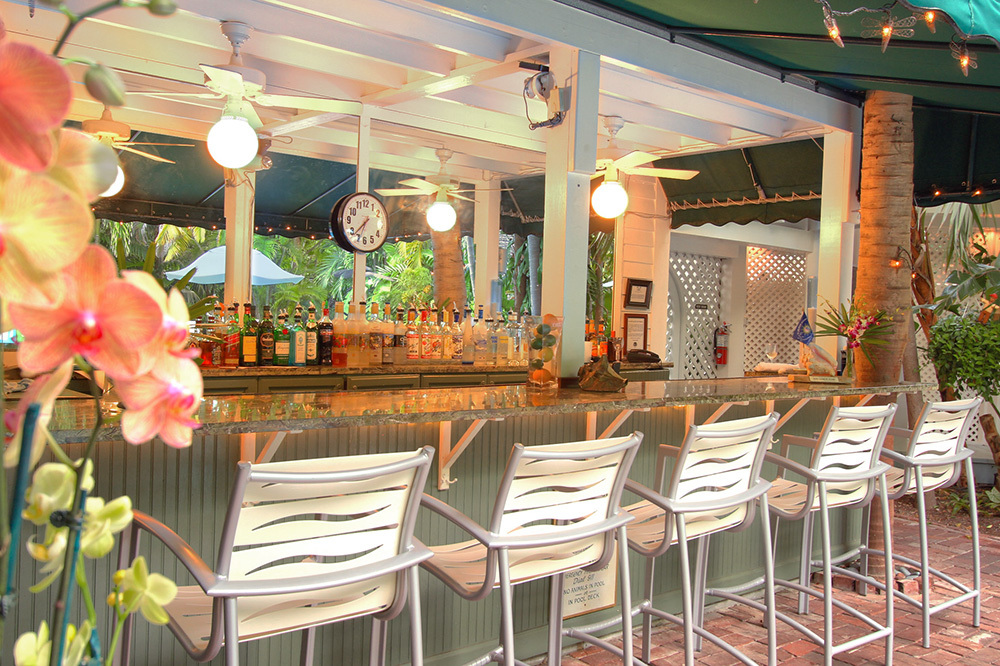 An Outdoor Bar At The Gardens Hotel In Key West, Florida
