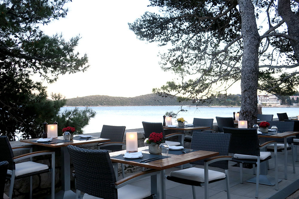 Outdoor seating of the restaurant at Lešić Dimitri Palace in Korčula, Croatia