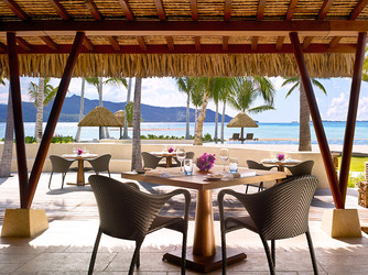 Patio dining at Four Seasons Bora Bora