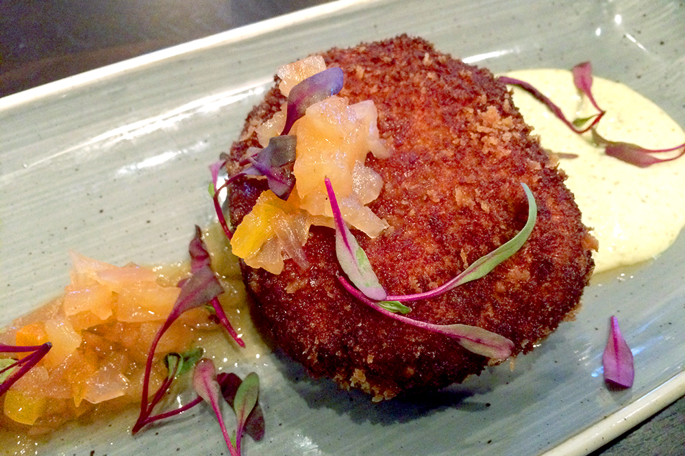 Plump crab cake with a roasted poblano aioli and pineapple chutney at <em>The Copper Grouse</em>
