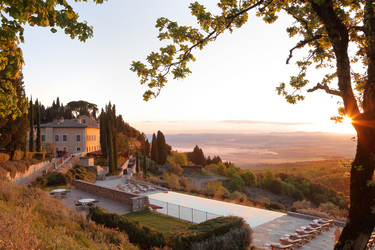 The Sunset Pool view at Rosewood Castiglion Del Bosco in Tuscany, Italy