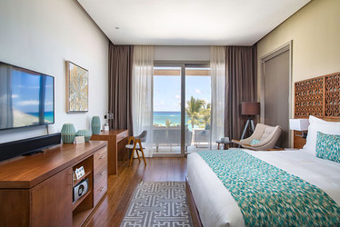 The Beachfront Two Bedroom Suite master bedroom at Eden Roc at Cap Cana