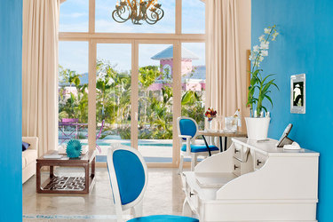 The Two Bedroom Family Suite living area at Eden Roc at Cap Cana