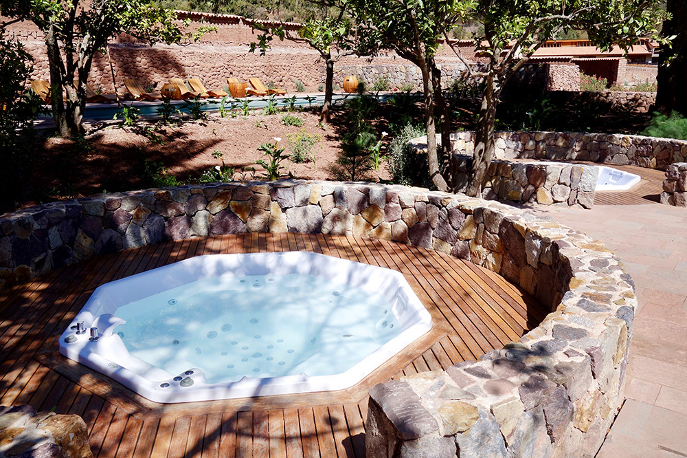The hot tub at the Spa Pumacahua Bath House at explora Valle Sagrado in the Sacred Valley, Peru