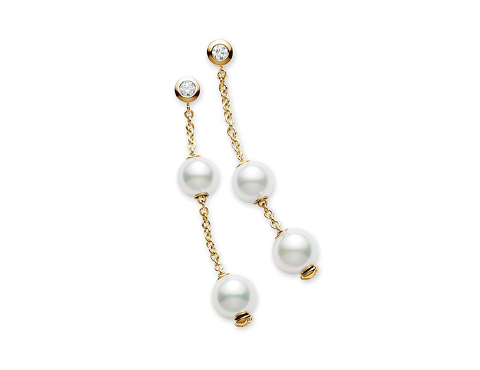 Mikimoto Pearls in Motion Collection akoya pearl and round brilliant cut diamond earrings in 18k yellow gold.