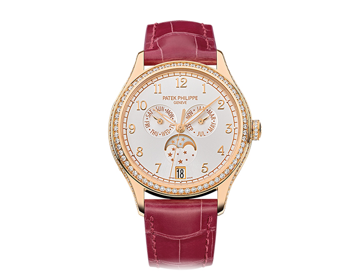Patek Philippe ladies 18k rose gold annual calendar mechanical self-winding diamond case strap watch featuring a silvery sunburst dial. (4947R-001)