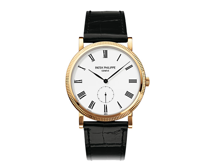 Patek Philippe Calatrava mens 18k yellow gold mechanical manually wound strap watch featuring a white lacquered dial. (5119J-001)