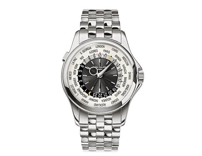 Patek Philippe World Time mens 18k white gold mechanical self-winding bracelet watch featuring 24-hour and day/night indication for 24 time zones. (5130/1G-010)