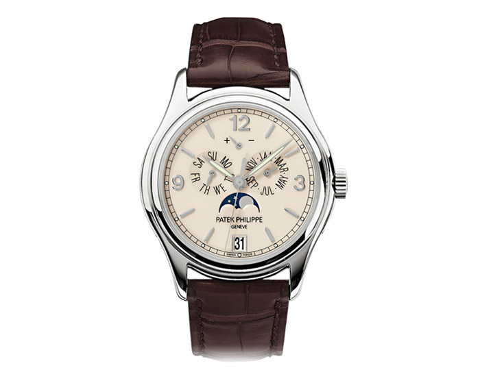 Patek Philippe annual calendar men's 18k white gold mechanical self-winding strap watch featuring day and month by hands, date in an aperture and moon phases with a cream dial. (5146G-001)